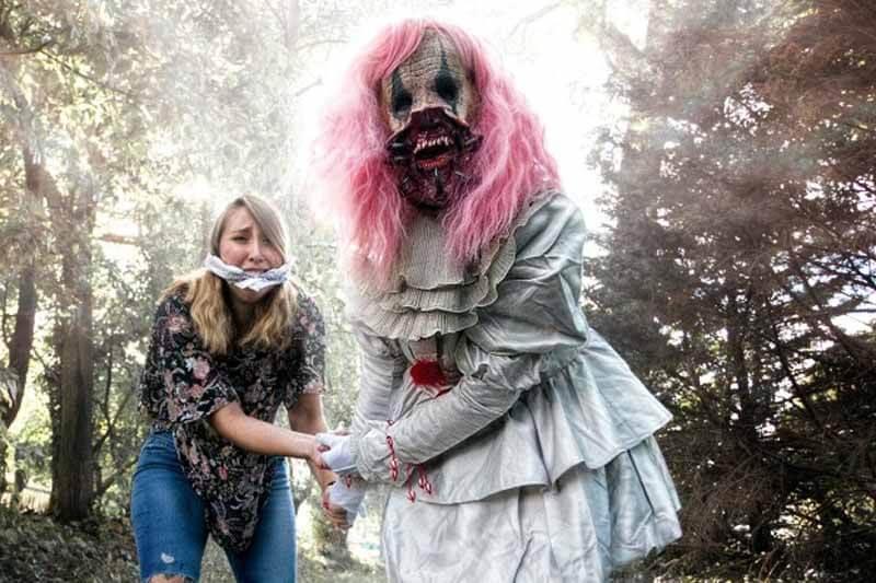 DarkWood Manor Haunted House in Virginia zombie monster torturing a girl